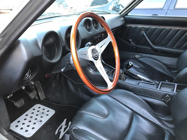 RX-8 seats 3