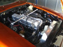 L28 engine w/carbs. Electronic Pertronix ignition. Coated header, Custon Built Air Breather
